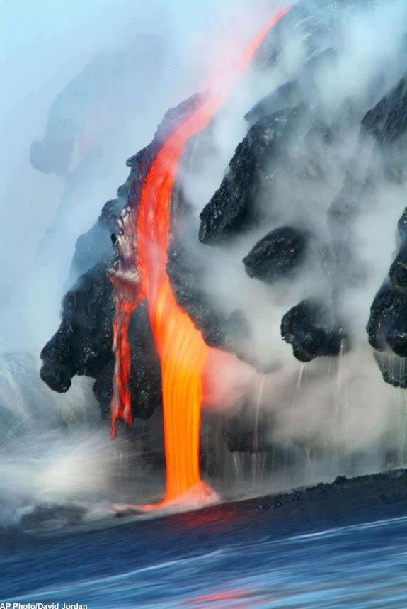Lava from the Kilauea Volcano in Hawaii Volcanoes National Park flowing into the Pacific Ocean