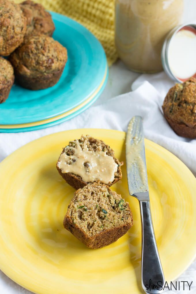 These whole wheat zucchini muffins are easy to prep on the weekends for a healthy grab-and-go snack or breakfast option during your busy week! | slimsanity.com