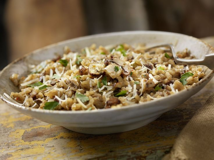 This low-fat recipe for creamy mushroom risotto is made with Arborio rice, and cremini and shiitake mushrooms for a satisfying dish without butter.