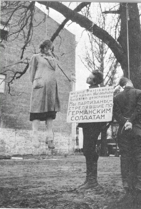 Russians accused of being partisans hang from a tree. Myriads of such atrocities took place all across the conquered Eastern territories. Germany never paid a red cent for her handiwork and how she treated millions like animals for slaughter.