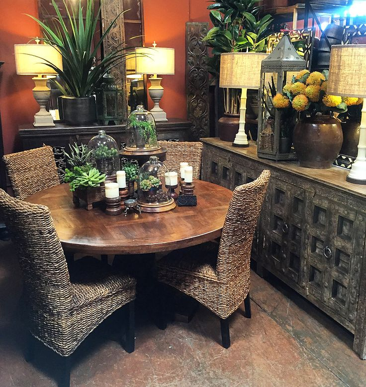 """Rustic elegance - 60"""" round dining table - old door buffet - layers of succulents and woven rush chairs - casual, old world - comfortable  Tierra Del Lagarto - Scottsdale Furniture Store"""