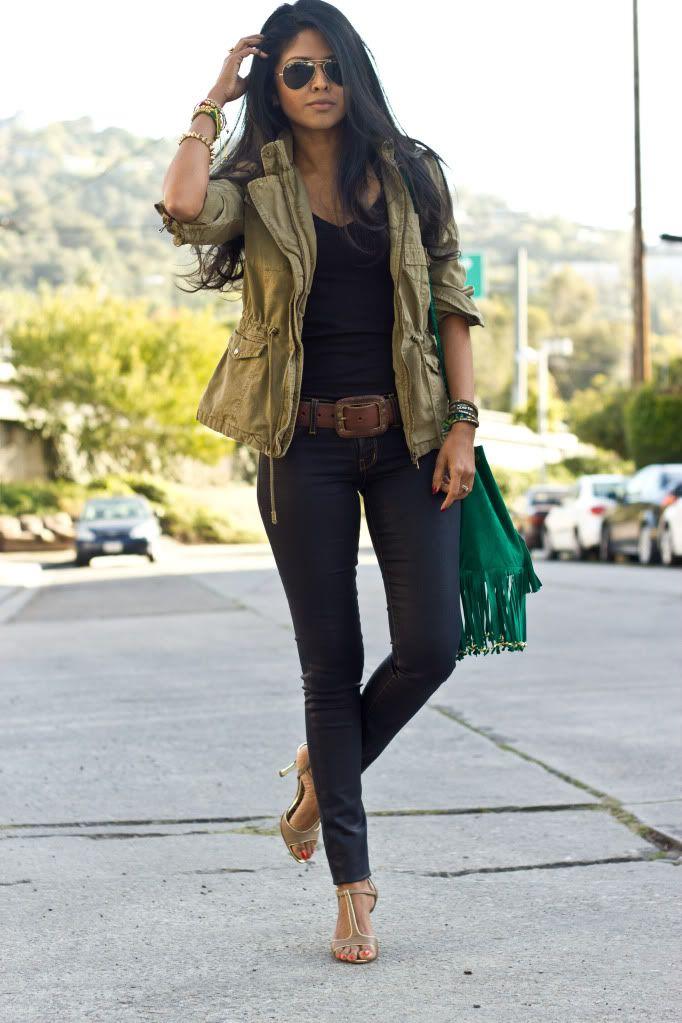 black shirt, dark denim jeans, army green jacket and aviators