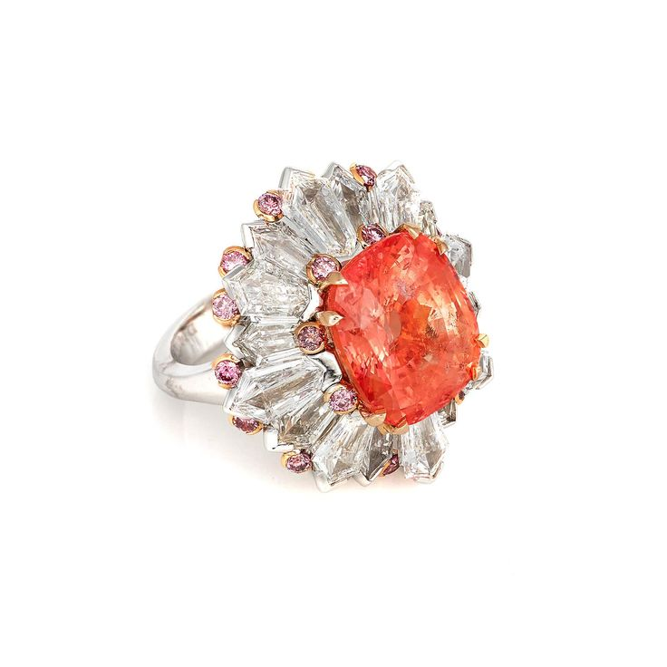 David Morris peach coloured 12.30 carat Padparadascha sapphire from Ceylon cocktail ring with white and pink diamonds. Discover the most amazing jewellery we saw at Paris Couture week from all the main jewelry houses showcasing stunning fashion and jewels: http://www.thejewelleryeditor.com/jewellery/article/perfect-10-favourite-jewels-paris-couture-week/ #jewelry