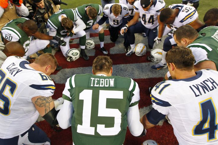 Quarterback Tim Tebow #15 the New York Jets leads a players prayer after their game against the San Diego Chargers at MetLife Stadium on Dec...