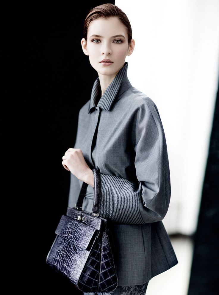 Fine wool weather-resistant coat with embroidery stitching. Storm system.  Crocodile calf-skin single handle mini bag.