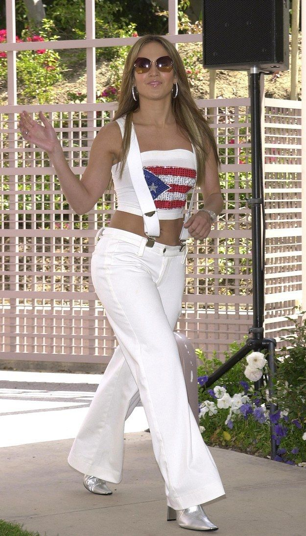 Jennifer Lopez's oversize suspenders and wide-leg white pants. | Can You Make It Through These Early 2000s Outfits Without Screaming For Mercy?