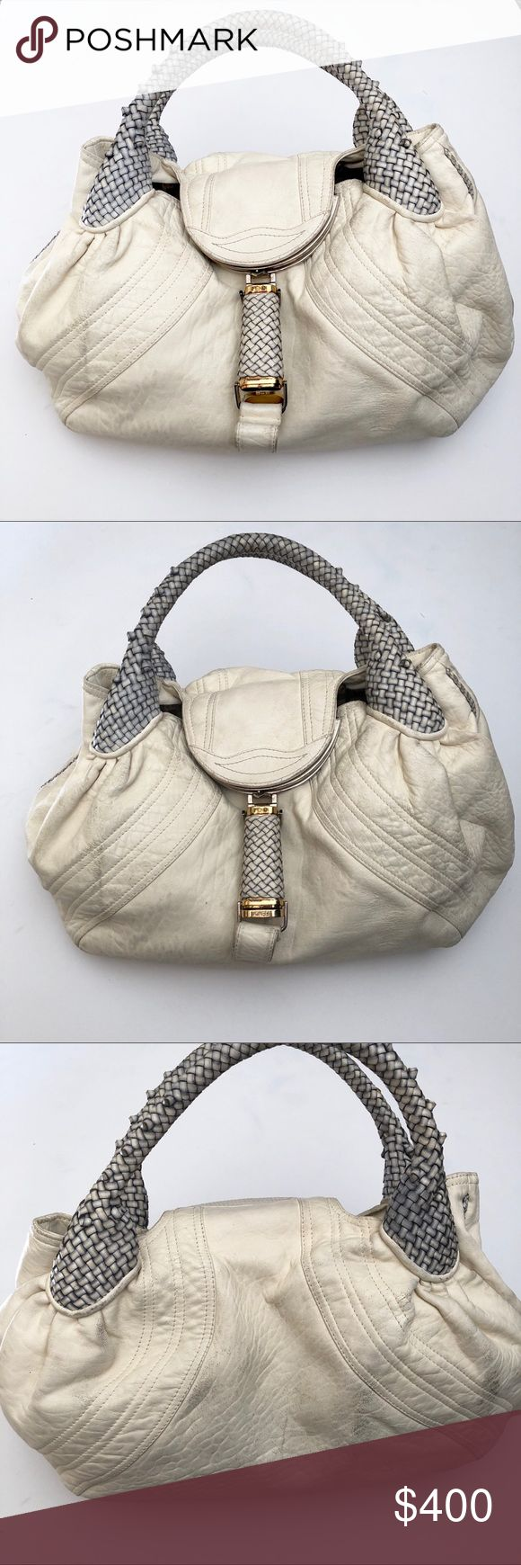 """Fendi White Blue Nappa Leather Spy Bag 100% authentic. This Spy Bag is popular among celebrities like Paris Hilton + Kim Kardashian! Cream leather, blue woven handles. Secret compartment on flap closure and one on the handle. Dark marks are not dirtiness but cracking leather. Please check all photos. PRICE REFLECTS CONDITION Authentic Code:2415-8BR511-RQ1-068 Measurements:16"""" L x 6"""" W x 9.75"""" H Overall Cond: Good, used w/ flaws but lots of life left Exterior:Cracking leather, corner flaws…"""