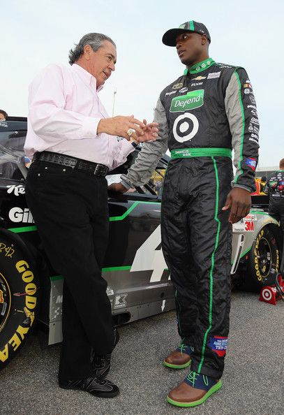 Demarcus Ware Photos - (L-R) Car ower Felix Sabates talks with Dallas Cowboys defensive end DeMarcus Ware on the grid before the NASCAR Sprint Cup Series Toyota Owners 400 at Richmond International Raceway on April 27, 2013 in Richmond, Virginia. - Toyota Owners 400