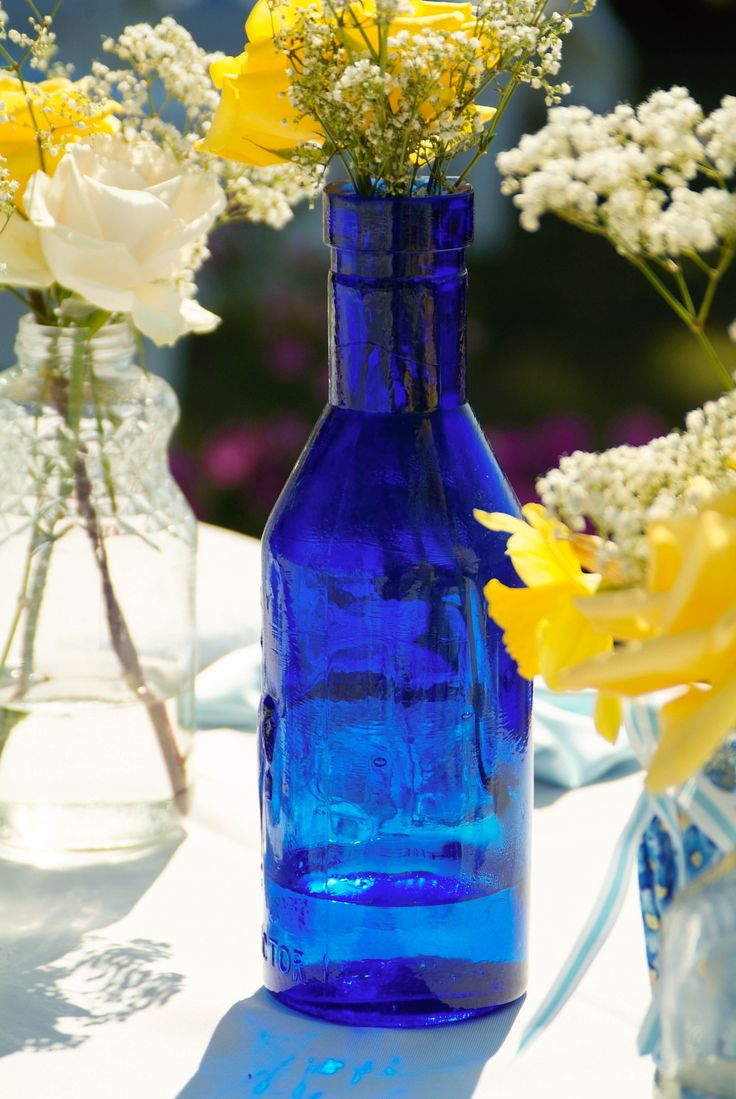 Use blue tinted glass for centerpieces?