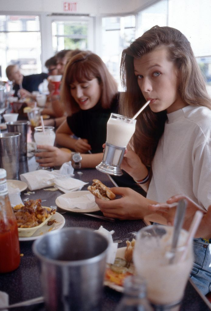 Milla Jovovich eating a Cheeseburger, Chocolate Malt and Chili Cheese Fries at Johnny Rockets, on Melrose in Hollywood