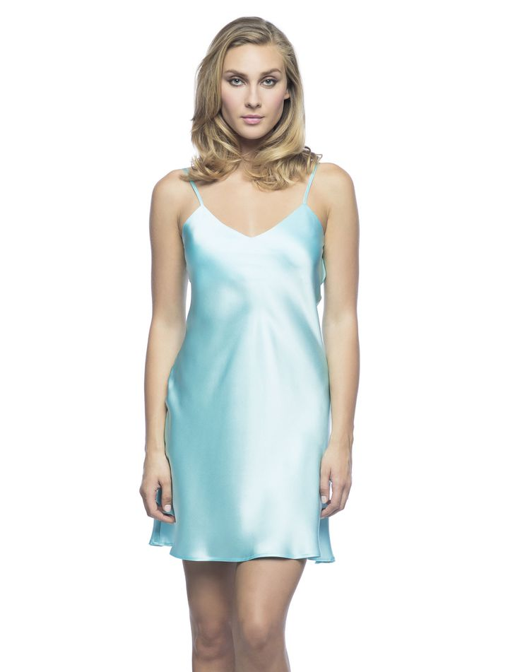 $180 Corazon Slip Du Jour in Aqua. Tropical-Optical slip!  Living-wear at its best bias-cut silk slip, practically lined front and back neckline featuring golden adjustable spaghetti straps ideal to sparkle under the sun.