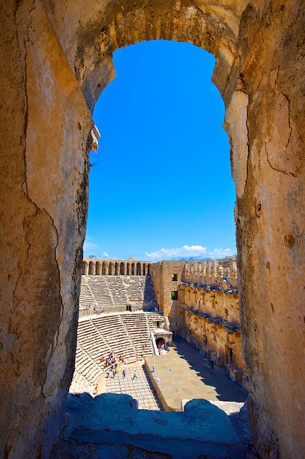 The Roman Theatre of Aspendos, Turkey. Built in 155 AD during the rule of Marcus Aurelius, it is the best preserved ancient theatre in Asia Minor. 96 metres in diameter, it can seat 7000. The csaenae frond or backdrop wall is still intact. Following Hellenistic traditions the theatre is built into the hillside below the Acropolis. COPYRIGHT : © Paul Edward Williams 2012. All rights reserved.