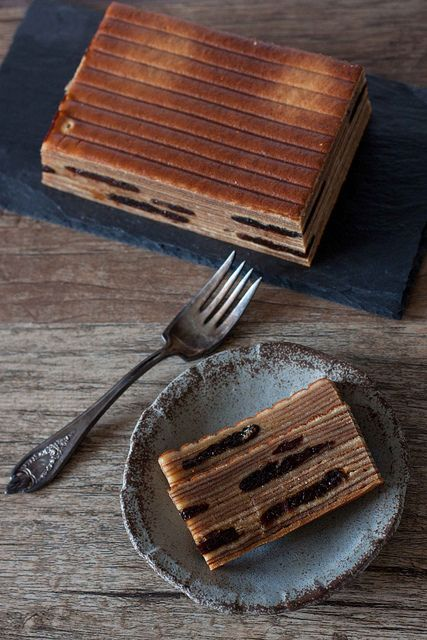 Spekkoek or Kueh Lapis - A Dutch Indonesian spiced butter cake. Made by meticulously grilling layers upon impossibly thin layers of batter....