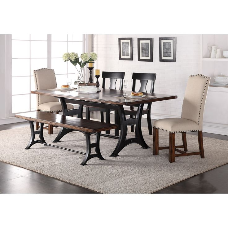 This eclectic dining table set will be an excellent update to your dining room. The set blends old and new with a Victorian style trestle base, upholstered Parson chairs and rustic wood finishes. The result is a polished and sturdy set mixing styles, colors, and materials. The unique seating configuration has two upholstered chairs, two wooden chairs, and a dining bench.