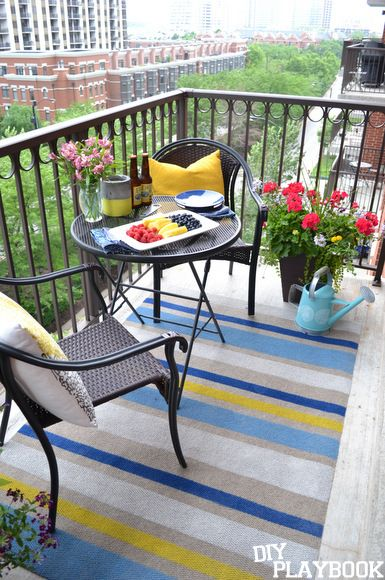 Here's an easy and inexpensive way to create a striped outdoor rug. This painted rug DIY is perfect for a city balcony or even a large patio space!