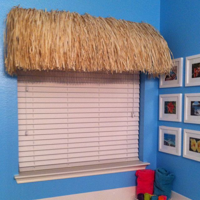 """Tiki Hut window treatment!  Great for tropical bathroom designs.  Used: 3 grass skirts, 2 shelf """"L"""" brackets and 2 wooden 1/2 moon rods. Glue the skirts to the one rod and attach to the top """"L"""" bracket on the wall. Draped the skirts over the other rod that is attached to the other end of the """"L"""" bracket. Super easy and under $35 to complete!"""