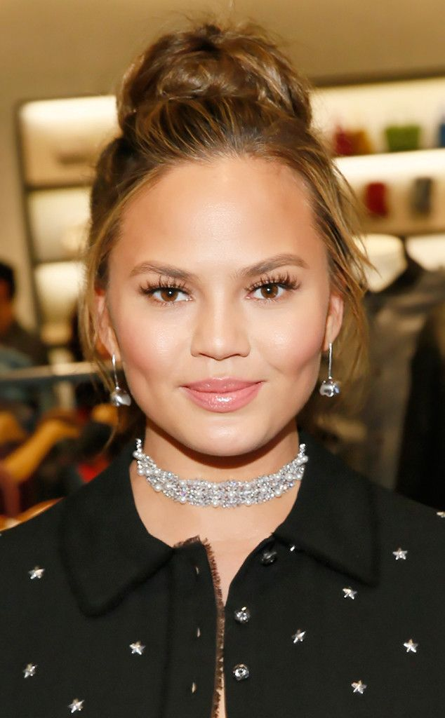 High Bun from Chrissy Teigen's Best Hair Looks  A high, teased bun is one of the model's go-to styles. It's polished enough for red carpet appearances, but casual enough for everyday.