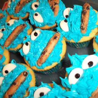 Cookie Monster cupcakes. Vanilla cupcakes with icing dyed blue, halved white chocolate wafers for his eyes and halved cookies as the mouth. My son and his class loved these!
