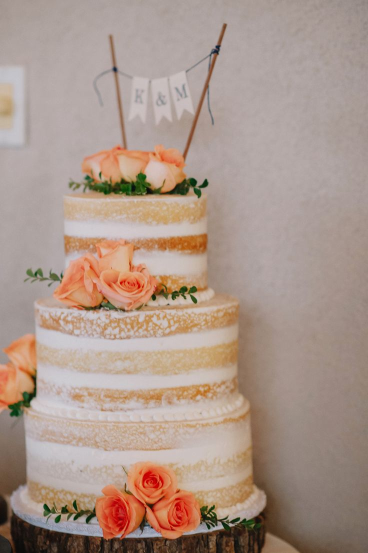 The three-tier naked cake had a dusting of white powder on its surface and had flavors of vanilla bean goodness. The dessert had peach roses accenting the top and sides, in addition to the flag topper made of burlap that mirrored many of the other linens.