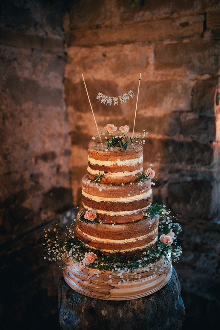 Naked Cake on Wooden Tree Stand and Mini Bunting Cake Topper | Autumn Wedding | Justin Alexander bridal gown | Lyde Court | Coral Rose Bouquet | Naked Wedding Cake | Images by Lucy Greenhill Photography | http://www.rockmywedding.co.uk/gemma-alfie/