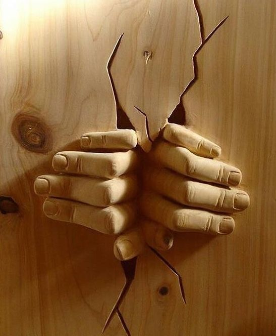 Wood sculpture: with both hands.