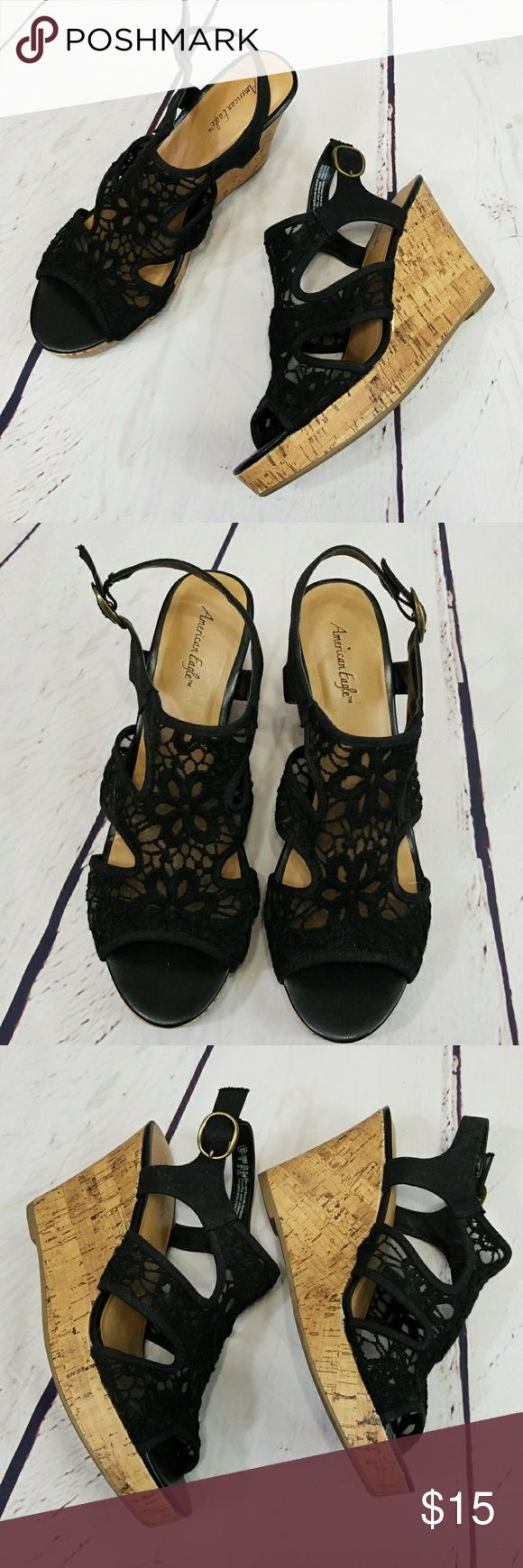 """American Eagle black lace wedges EUC American Eagle black lace wedges with buckled ankle straps. 1"""" platform and 4"""" heel. Size 10. Fabric upper/balance man made materials. American Eagle By Payless Shoes Wedges"""