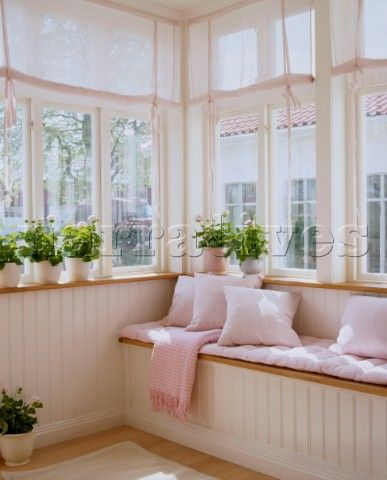 Wide comfortable window seat - this would work well in my porch.