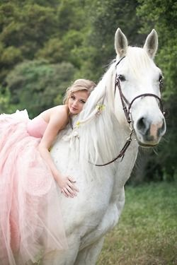 Lovely pink wedding or prom dress. Professional photograph of young woman in a long formal gown peacefully smiling, lying bareback against a gorgeous white horse. - DdO:) MOST POPULAR RE-PINS - http://www.pinterest.com/DianaDeeOsborne/gorgeous-horses-more/ - GORGEOUS HORSES AND MORE. A great portrait photo composition for a special occasion. Notice the perked up, interested ears of the alert stallion. Nice pin via Karen Harrison.