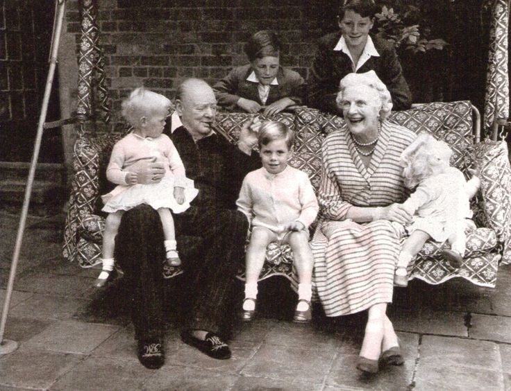 Winston Churchill and family on the family swingseat - Chartwell, Kent - c1951. Churchhill enjoyed children. He was warm and fun with them.