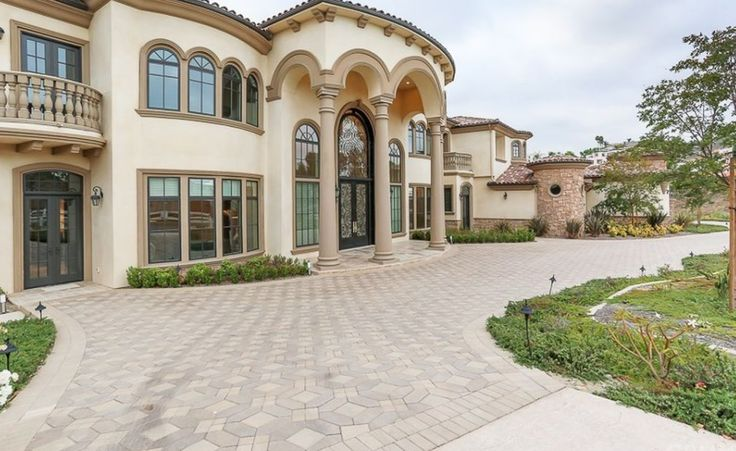 This stucco & stone mansion is located at 2127 Derringer Lane in Diamond Bar, California and is situated on 1.7 acres of land.