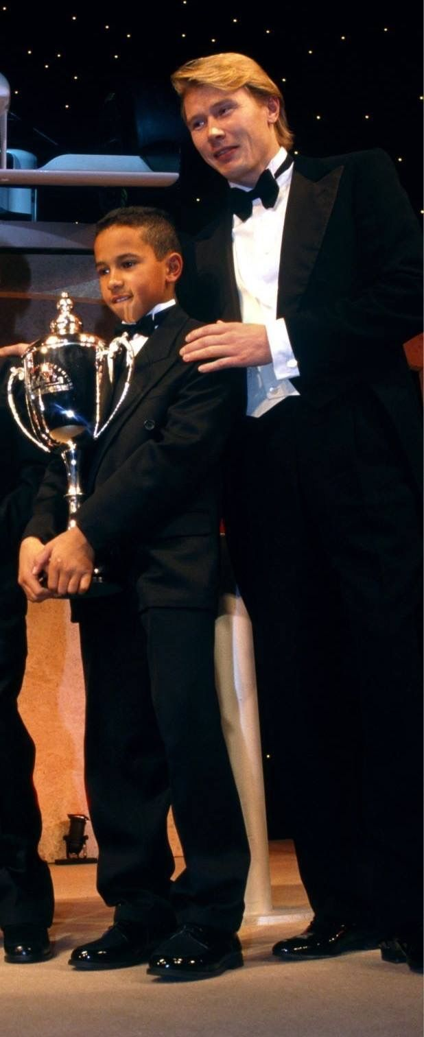 Mika Hakkinen with a very young go-karting Lewis Hamilton