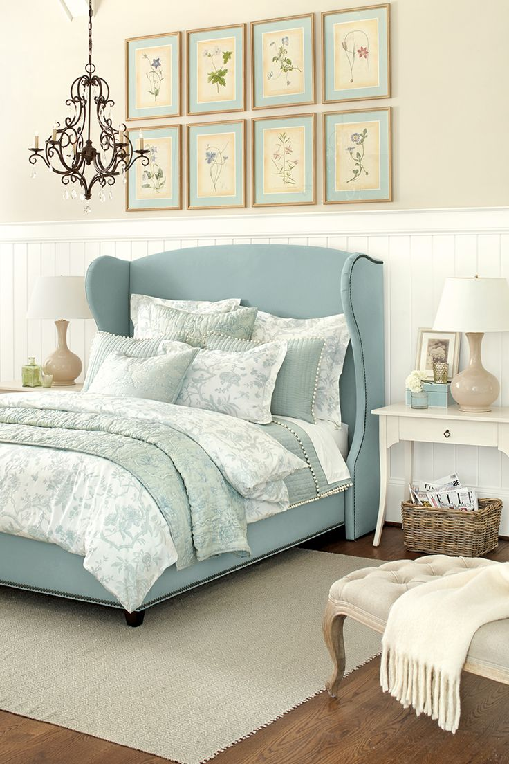 17 best images about for the home on pinterest master bedrooms cottage bedroom from ballard designs i like the wing back style headboard in cool blue linen with nail head trim the eight botanical prints are lovely