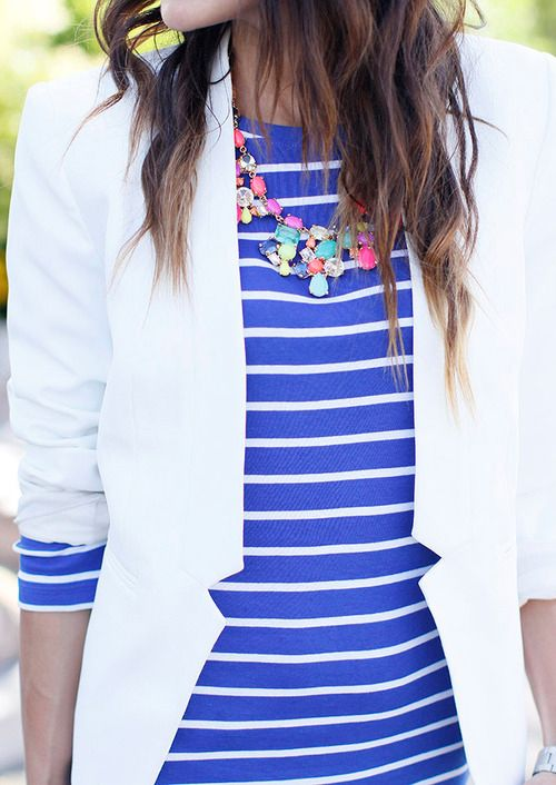 Blue striped shirt, white blazer, colorful necklace