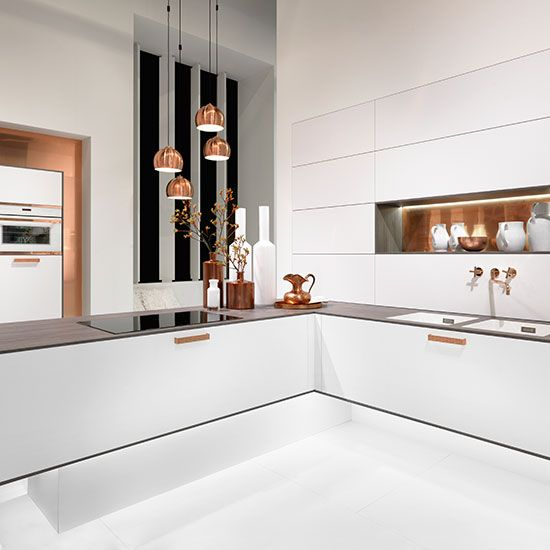 Has modern mimimalism ever looked so good? Stunning white kitchen from Rational, www.kitchensourcebook.co.uk/wp-content/uploads/2015/04/Topaz-kitchen-in-white-2-from-Rational.jpg