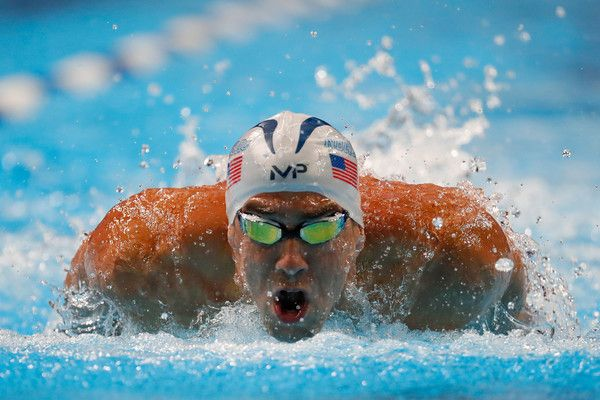 Michael Phelps Photos Photos - Michael Phelps of the United States competes in a heat for the Men's 100 Meter Butterfly during Day Six of the 2016 U.S. Olympic Team Swimming Trials at CenturyLink Center on July 1, 2016 in Omaha, Nebraska. - 2016 U.S. Olympic Team Swimming Trials - Day 6