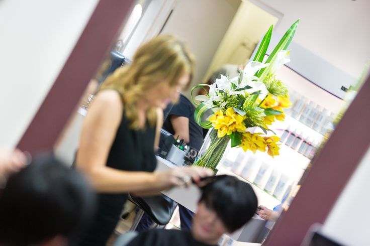 Oriental Lily and yellow Cymbidium Orchids by Floral Instinct