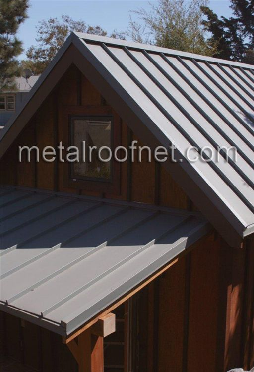 These are finished steel roof panels in a pale grey contrasting a rustic  wood exterior.