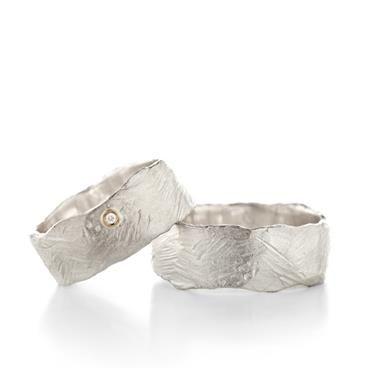 Wide wedding rings with rough structure   Wim Meeussen Goldsmith Antwerp