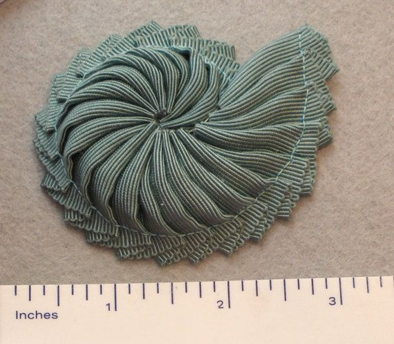 Hey, I found this really awesome Etsy listing at http://www.etsy.com/listing/152764640/nautilus-shell-ribbon-cocarde-applique