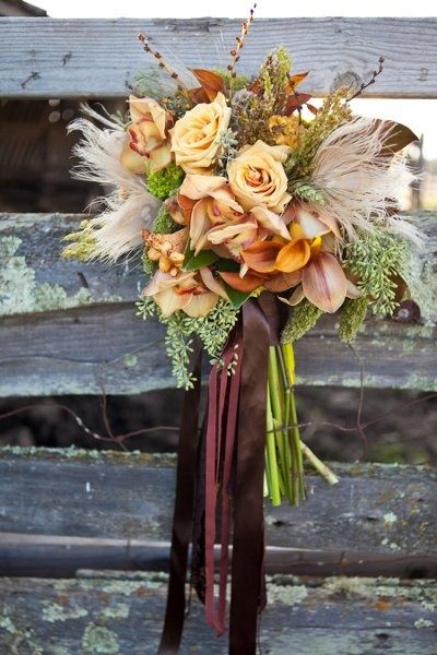 #Fall #wedding #bouquet love the feather details and the ribbon www.CharmingGraceEvents.com