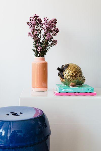 Rushcutters Bay Apartment - Emma Blomfield Interior Stylist Sydney. Living Room. Vignette Ideas. Gold Strawberry. Soft Colours. Flower Decor. Blue Drum Stool.