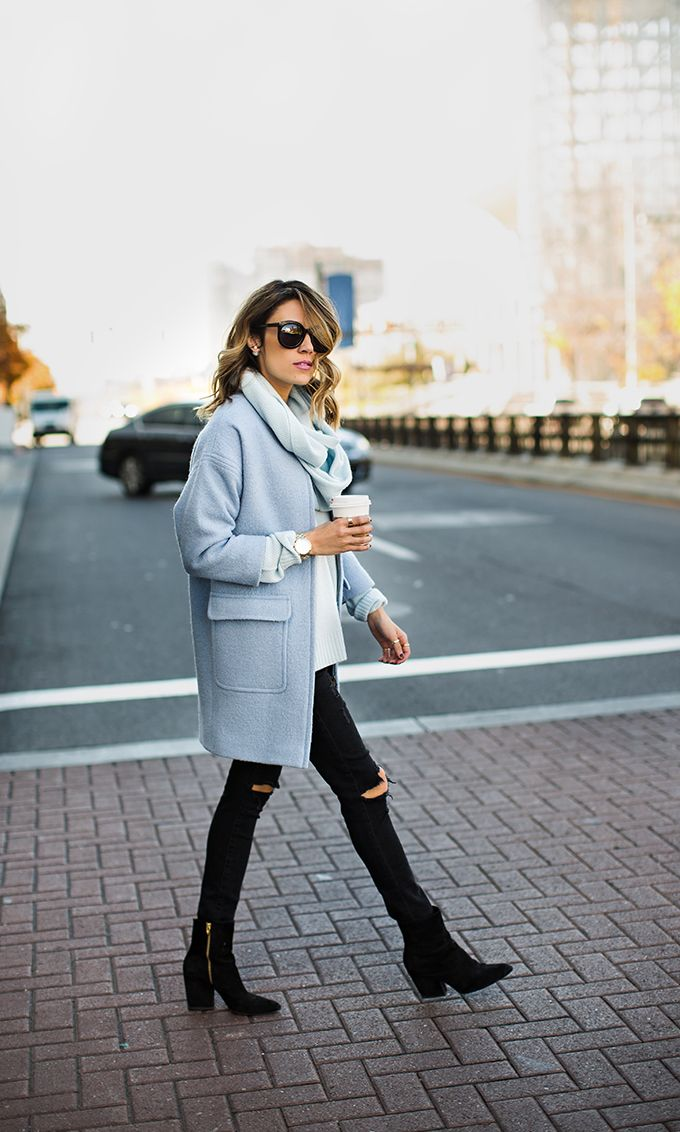blue cocoon coat. black ripped jeans.