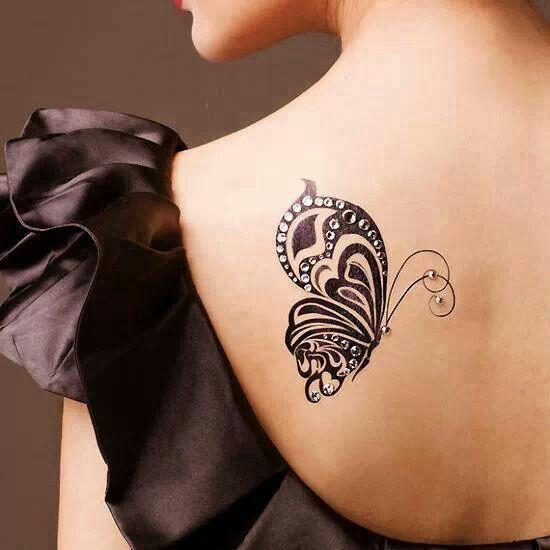 Butterfly with dermal piercings