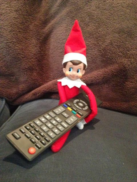 Elf on the Shelf watching tv. Get your elf on the shelf at Seasons by Design specialty shop, 2605 Ford Drive, New Holstein, WI 53061.       920-898-9081 Seasonsbydesigngifts@yahoo.com  Follow us on Facebook