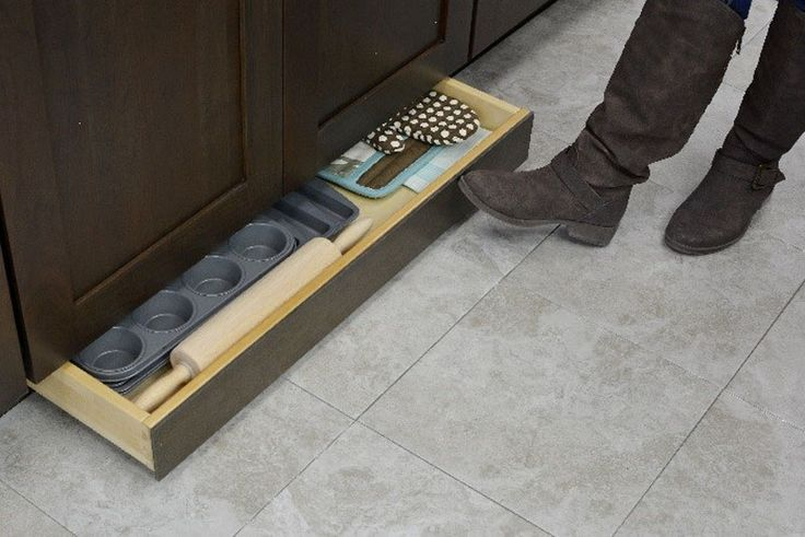Kitchen Design Idea - Toe Kick Drawers // Great for storing baking equipment.