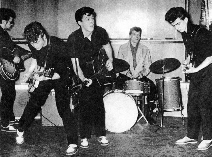 A rare photo of the Silver Beetles, rocking out on the stage in 1960 — only months away from changing their name officially to The Beatles.