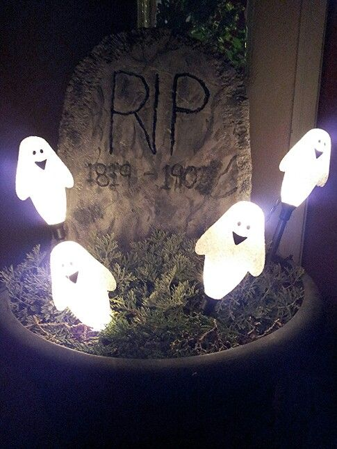 Hey y'all! This is what i made the tombstones for. Homemade tombstone, plants from my garden and ghost lights. Total bill for all $30 and you made two plant pots into a haunted graveyard. (GHOSTS $17.99 WITH 40% OFF AT HOBBY LOBBY; DISCOUNT MAY BE FOR CERTAIN AREAS BUT THEY ARE FOR SURE $17.99 AND IT COMES WITH A SET OF 4 PER BOX) HG
