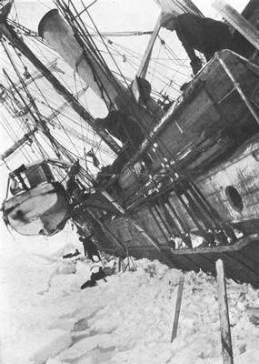 """October 19, 1915 This photograph shows Shackleton leaning over the ship. At this point, Shackleton realized the end of the ship was near. The photograph is entitled """"The beginning of the end"""" A week later they abandonded ship."""