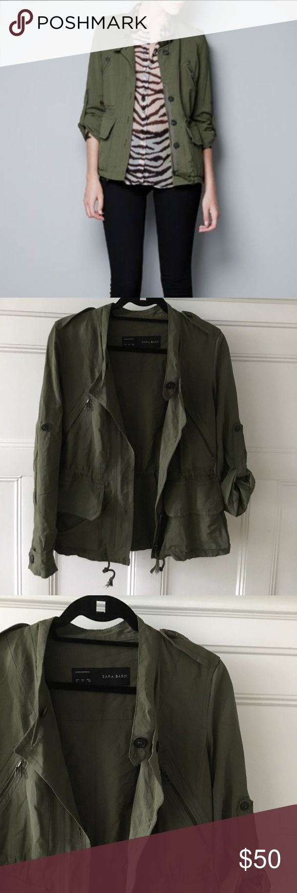Zara Army Jacket Zara army jacket with amazing detailing! Slightly cinched waist, sleeve can be rolled up or worn down, amazing button and zipper detailing. Great condition-- worn once! Buttons down the front, but closes with zipper. Zipper tie is frayed naturally. Zara Jackets & Coats Utility Jackets