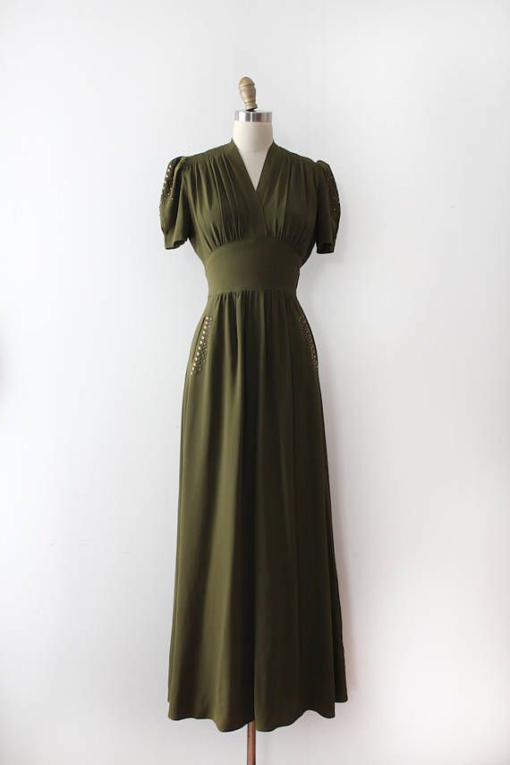 INCREDIBLE late 1930s studded evening gown! This dress features beautiful multi coloured jewelled studs with little leaf stud details on the sleeves and skirt pockets, a beautiful flattering silhouette overall, and a lovely neckline.